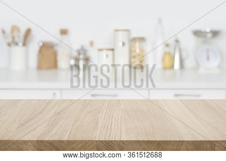 Tabletop Over Blurred Kitchen With Copy Space For Your Composition