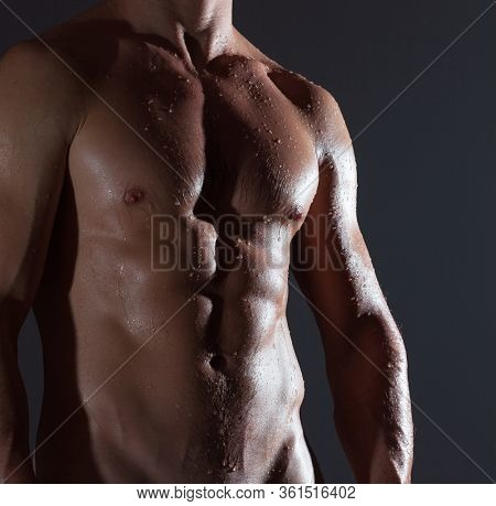 Muscular man with wet body