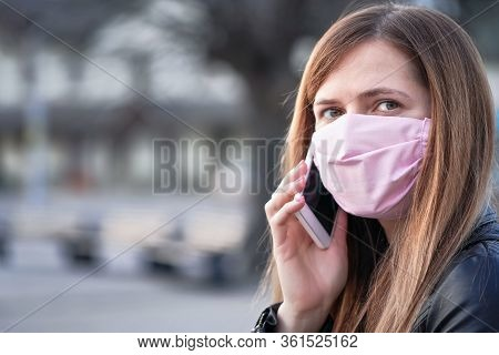 Young Woman With Hand Made Face Nose Mouth Mask Talking On Her Mobile Phone, Close Portrait, Space O