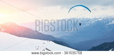 Banner. The Landscape Of The Ski Resort. Skiers And Snowboarders Are Rolling Down The Mountain. Para