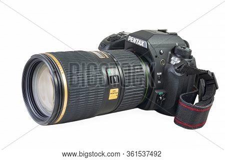 West St. Paul, Mn/usa - April 14, 2020: Pentax Brand Digital Slr Camera Model K5 And Zoom Lens Attac