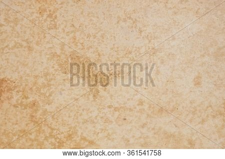 The Surface Is Beige. Cardboard Cover Of An Old Book. View From Above. Large Brown Spots, Scuffs, St