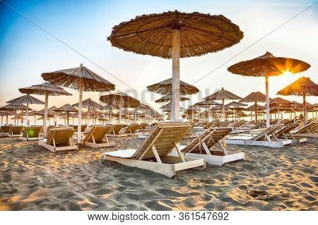 Sun Umbrellas And Deckchairs On The Copacabana Beach, Part Of Great Beach (velika Plaza) In Ulcinj.