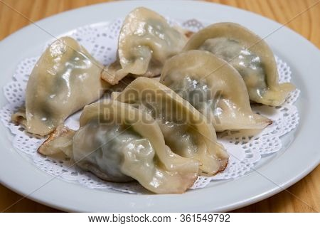 Chinese Food Called Shumay Dimsum On A White Dish