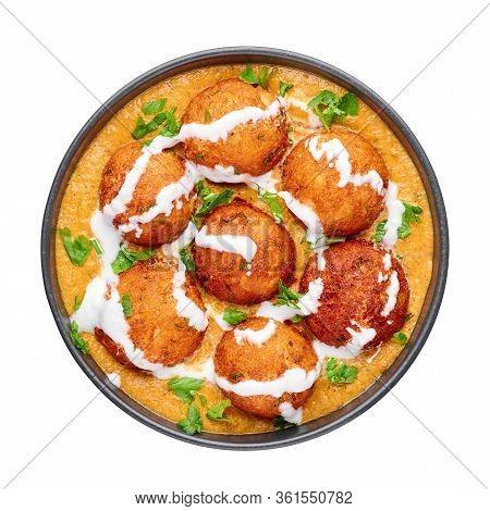 Malai Kofta Curry In Black Bowl Isolated On White Background. Malai Kofta Is Indian Cuisine Dish Wit