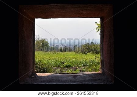 View Of A Agricultural Land Thru Window Of A House