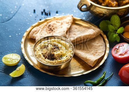 Oriental Food - Indian Paneer Sabji With Chapati And Sauce. Indian Cuisine. Indian Curry In Copper B