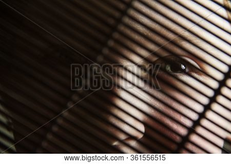 The Girl Behind Bars. Eyes Behind The Blinds.