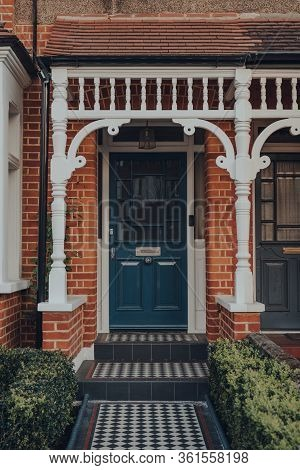 Navy Stained Glass Front Door Of A Traditional Edwardian House With Checkerboard Tiles Entrance In L