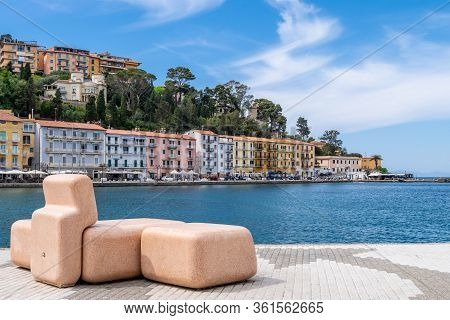 Porto Santo Stefano, Grosseto, Tuscany, Italy, April 2018: Bench On Seafront In Porto Santo Stefano