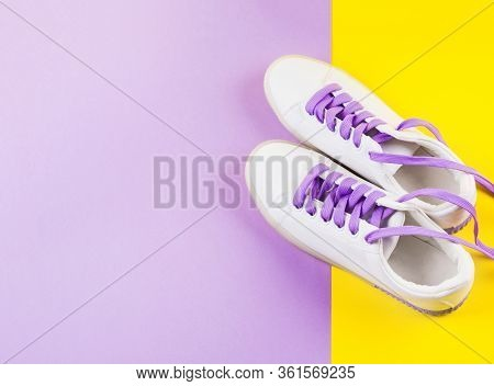 White Sneakers With Purple Laces On Yellow And Purple Split Background. Modern Minimal Fashion Art T