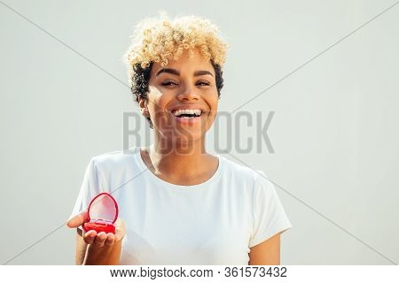 Proposal Of A African American Woman Asking Marry To A Man At White Studio Background