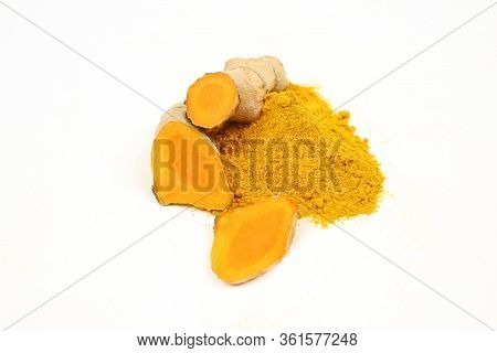 Turmeric Powder And Turmeric Roots Isolated On A White Background.turmeric Is Used As A Tonic For Th