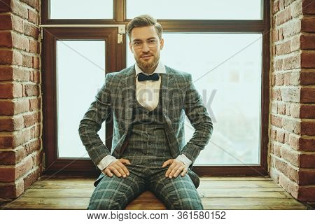 Portrait of a handsome gentleman with a beard and mustache wearing elegant suit and spectacles. Men's beauty, fashion. Businessman portrait. Optics for men.