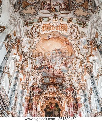 Feb 1 , 2020- Steingaden, Germany: Rococo Style Ceiling Fesco Above Altar Inside Pilgrimage Church O
