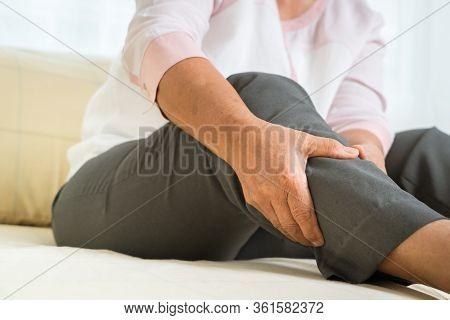 Leg Pain Of Senior Woman At Home, Healthcare Problem Of Senior Concept