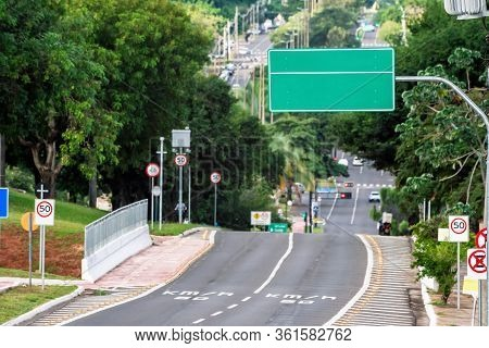 Photo With Focus On A Big Green Transit Sign Of A Avenue. Avenue With Electronic Fiscalization, 50 K