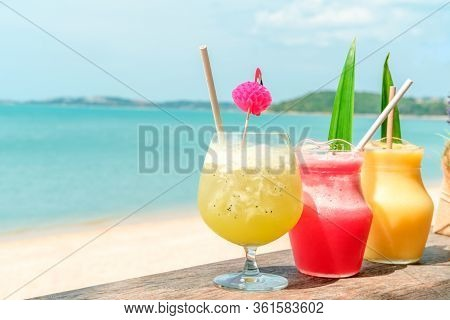 Colorful Mocktails At The Beach Bar With Sea Background. Vacation, Get Away, Summer Outing Concept