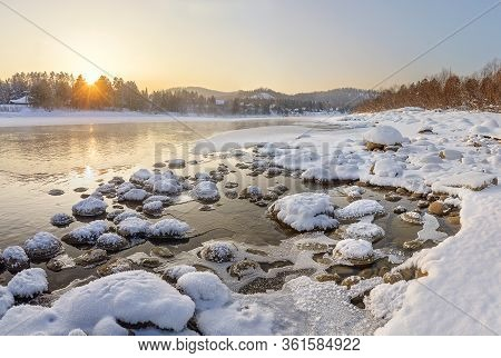 Altai, Russia - January 15, 2016. Sunset Over The Lebed River, Near The Village Turochak, Altai Moun