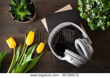 audiobook concept modern wireless headphones smartphone book