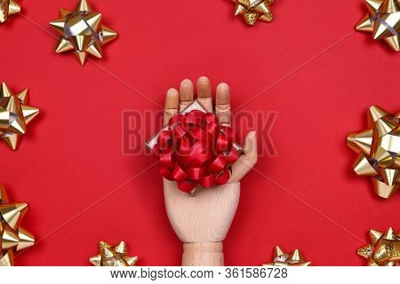 Futuristic Image With A Robot Hand Holding Gift Box With Red Bow On Red Drop With Golden Star Bows.
