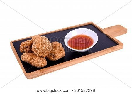 Hot Meat Dishes - Grilled Chicken Wings With Red Spicy Sauce. On A Wooden Board On A White Backgroun