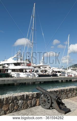The Old Style Cannon Standing By The Marina In Charlotte Amalie Town On St. Thomas Island (u.s. Virg