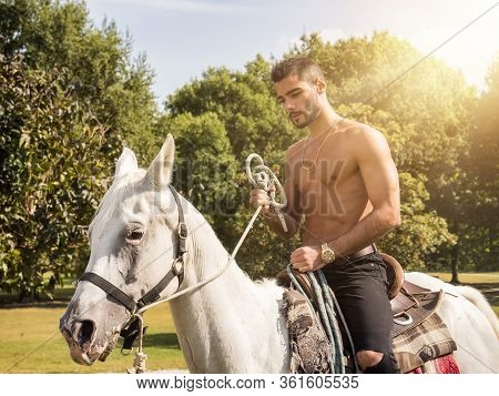 Sexy Shirtless Bearded Man On Horse In Countryside