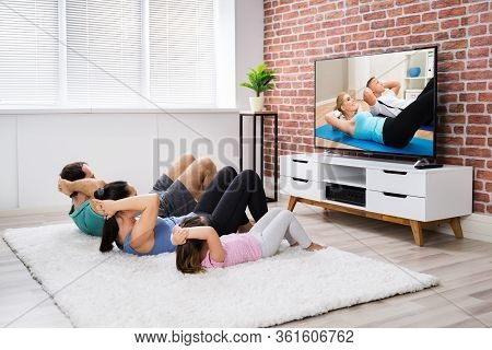 Fit Family Doing Home Online Fitness Exercise