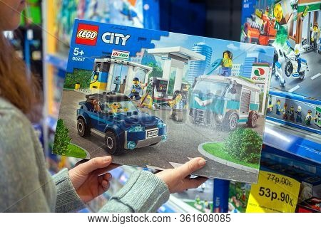 Minsk, Belarus - January 29, 2020: Buyer Chooses A Box Of Toys For Child.