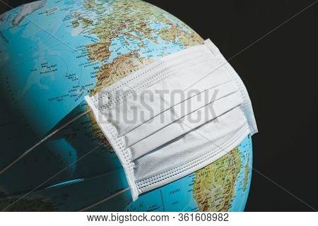 World Globe With White Medical Face Mask. Coronavirus, Covid-19 Concept. Expression Of Worldwide Loc