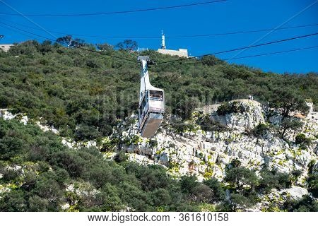 Gibraltar, Uk -february 20, 2020. The Cable Car Ascending To The Top Of The Rock Of Gibraltar. Briti