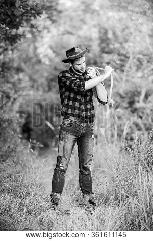 Man Wearing Hat Hold Rope. Ranch Occupations. Lasso Tool. American Cowboy. Lasso Tied Wrapped. Weste