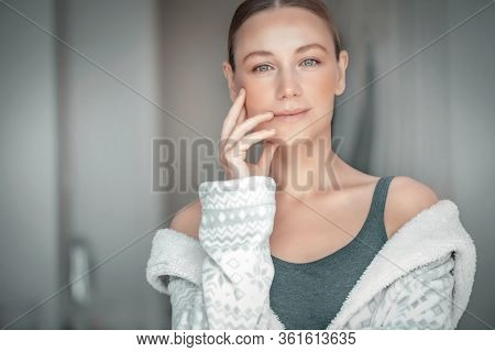 Portrait of a woman with authentic natural beauty, spending time at home, no makeup, real life, relaxation, happiness and peacefulness concept