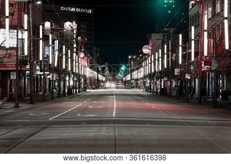 Downtown Vancouver, Bc, Canada - Apr 05, 2020: Saturday Night On An Empty Granville Street Due To Bu