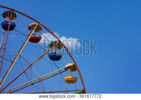 Fragment Of Ferris Wheel On The Background Of Blue Sky. Abstract Background With Ferris Wheel.