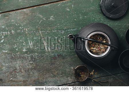 Tea composition flat lay, Teapot with dry tea leaves, Making tea