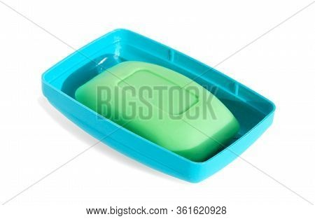 Green Soap Bar In Blue Soap Dish Isolated On White Background With Shadow.