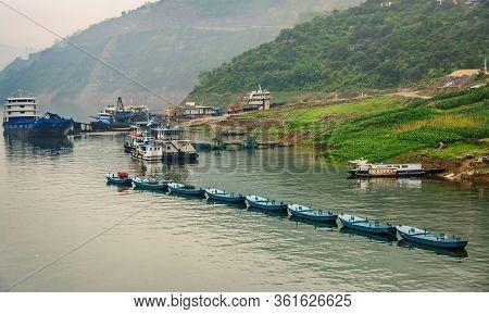 Baidicheng, China - May 7, 2010: Qutang Gorge On Yangtze River. Big Blue Trasnport Boats And Row Of