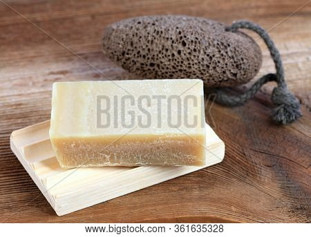 Bar Of Soap And On Wooden Pad And Pumice Stone In Rustic Style. Handmade Olive Oil  Soap And Pumice