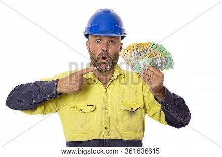 An Australian Worker Pointing In Amazement At A Pile Of Money He Is Holding.