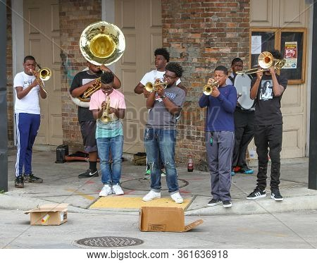 New Orleans, La - March 27, 2016: A Group Of Eight Young Men Entertain The Crowd By Playing Their Mu
