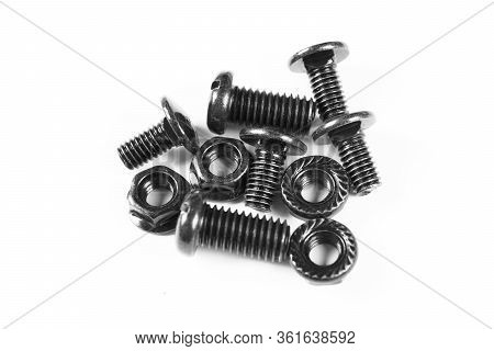 Black Metal Bolts And Nuts  In A Row. Black Screw Bolts And Nuts Isolated. Steel Bolts And Nuts Patt