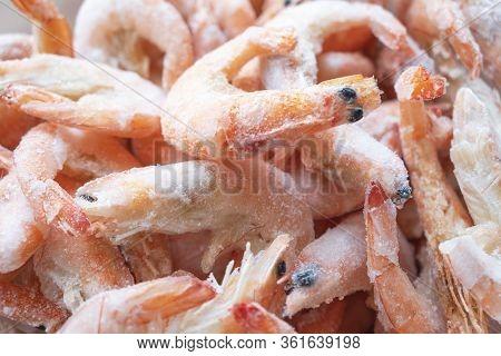 Frozen Big Shrimps Close Up. Raw Frozen Shrimp Background. Pile Of Frozen Shrimps Background