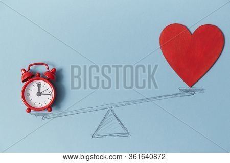 Red Alarm Clock And Blank Bright Heart On Scales, Copy Space. Love Vs Career Mockup. Doubts Of Soul.