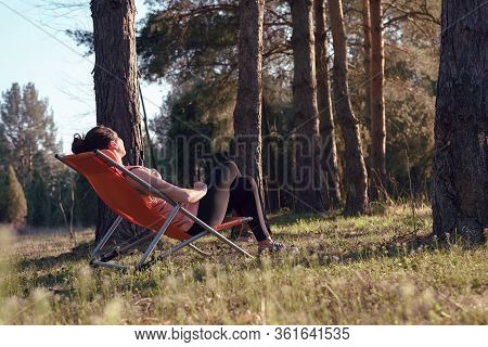Woman In Nature In Sunset. People In Nature..beautiful Woman Relaxing In Nature In Sunset. Beautiful