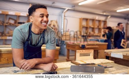 Male Student Studying For Carpentry Apprenticeship At College