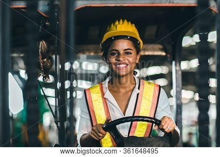 Women Labor Worker At Forklift Driver Position With Safety Suit And Helmet Happy Smile Enjoy Working