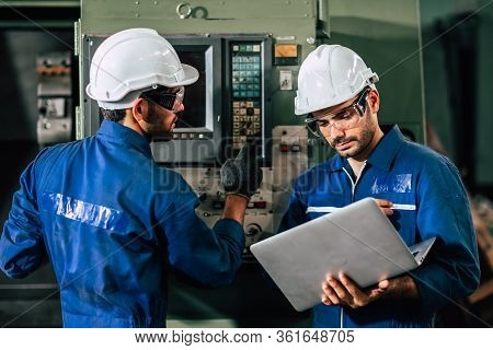 Industry Engineer Team Worker Operate Control Heavy Machine With Computer Laptop To Help Analysis Op