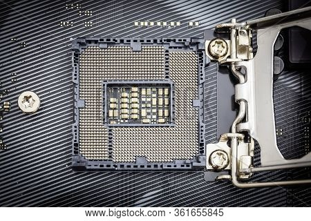 Closeup Detail Of Cpu Socket Of A Modern Computer Black Motherboard. Electronic Small Component Deta